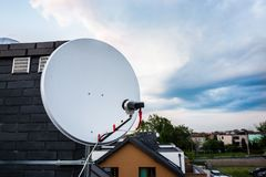 Satellite dish, satellite antenna mounted on the chimney Royalty Free Stock Images