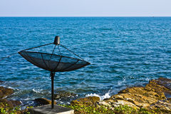 Satellite dish at the seashore Stock Photos