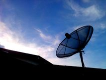 Satellite dish. Silhouette on sky background Stock Photo