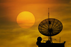 Satellite dish. The silhouette of satellite dish sunset background Royalty Free Stock Images