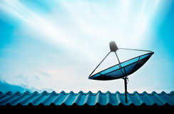 Satellite dish with sky Stock Images
