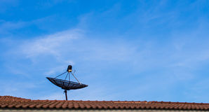 Satellite dish with sky on roof. Satellite dish with blue sky on roof Royalty Free Stock Images