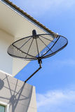 Satellite dish with sky on roof Royalty Free Stock Photos