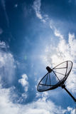 Satellite dish sky sun blue sky Royalty Free Stock Images