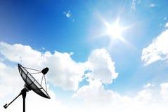 Satellite dish sky sun Royalty Free Stock Image