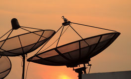 Satellite dish sky sunset Royalty Free Stock Photography