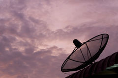 Satellite dish sky sunset Stock Images
