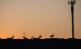 Satellite dish sky sunset communication technology network Stock Photos