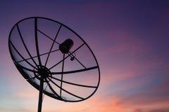 Satellite dish at sky sunset technology network Royalty Free Stock Photo