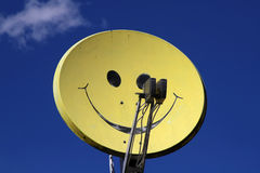 Satellite dish with smiley Royalty Free Stock Photos