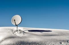 Satellite dish with snow Stock Photo