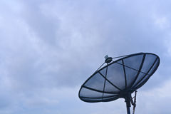Satellite dish in storm coming Stock Photos