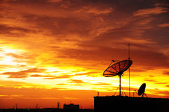 Satellite dish in the sunset. Satellite dish in the city on the sunset Royalty Free Stock Photo
