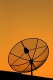 Satellite dish in sunset. Black antenna communication satellite dish in sunset sky Stock Photography