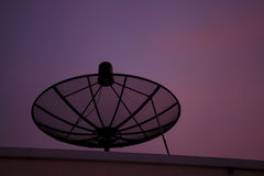 Satellite dish at sunset Stock Image