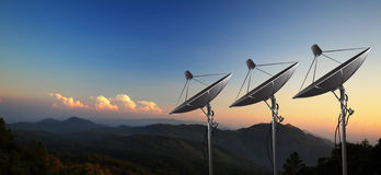 Satellite dish with sunset. Satellite dishes on summit with sunset Royalty Free Stock Images