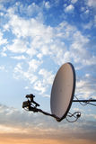Satellite dish. On sunset background Royalty Free Stock Photography