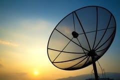 Satellite dish. On sunset blue sky, skies Stock Photos