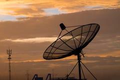 Satellite dish. On sunset blue sky, skies Stock Photo