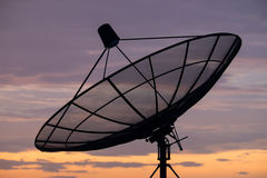 Satellite dish. On sunset blue sky, skies Royalty Free Stock Image