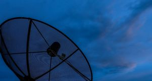 Satellite dish sunset clouds Stock Photography