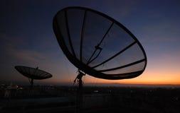 Satellite dish sunset. Communicatin industry Stock Photography