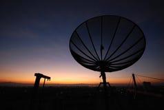 Satellite dish sunset. Communicatin industry Stock Photos