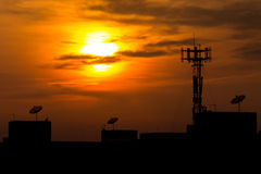 Satellite dish in sunset time. Satellite dish above the building in sunset time Stock Images