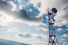 Satellite dish telecom network antenna tower at sky background, communication technology network Royalty Free Stock Images