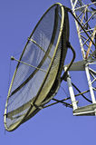 Satellite dish on a telecommunications tower Royalty Free Stock Images