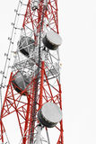 Satellite dish telecoms on telecommunications tower on white clear sky Royalty Free Stock Photo