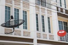Satellite dish and television antenna installed on the house. Satellite dish and television antenna installed on the outside house Royalty Free Stock Photos