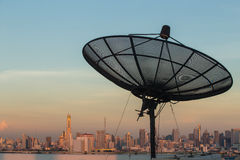 Satellite dish on top of the building Stock Images