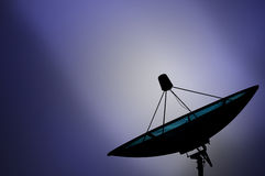 Satellite dish transmission data on blue background Royalty Free Stock Photography