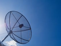 Satellite Dish Transmission Data On Bright Blue Sky Background. Satellite dish communication technology network Royalty Free Stock Photo