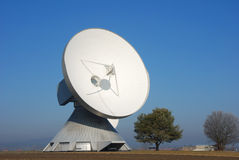 Satellite dish with trees. Communication ground station Royalty Free Stock Photography