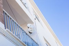 Satellite dish and TV antennas on the house royalty free stock photos