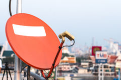 Satellite dish and TV antennas on the house roof with blue sky b Stock Photo