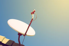 Satellite dish and TV antennas on the house roof Royalty Free Stock Photo
