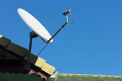 Satellite dish and TV antennas on the house roof Stock Photography