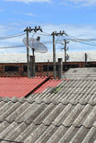 Satellite dish and TV antennas on the house roof Royalty Free Stock Image
