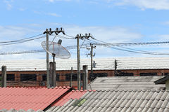 Satellite dish and TV antennas on the house roof Royalty Free Stock Images