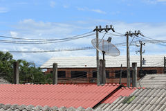 Satellite dish and TV antennas on the house roof Stock Image