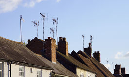 A satellite dish and TV arial Royalty Free Stock Photos