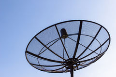 Satellite dish with twilight blue sky. Old single satellite dish with twilight blue sky background Stock Photography