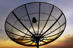 Satellite dish on twlight sky background Royalty Free Stock Image
