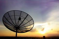Satellite dish on twlight sky background Royalty Free Stock Photos