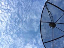 Satellite dish. Satellite under the cloud sky Royalty Free Stock Images