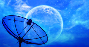 Satellite dish under moon night sky Royalty Free Stock Images
