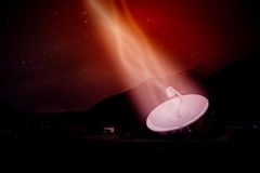 Satellite dish under a starry night sky Royalty Free Stock Photography